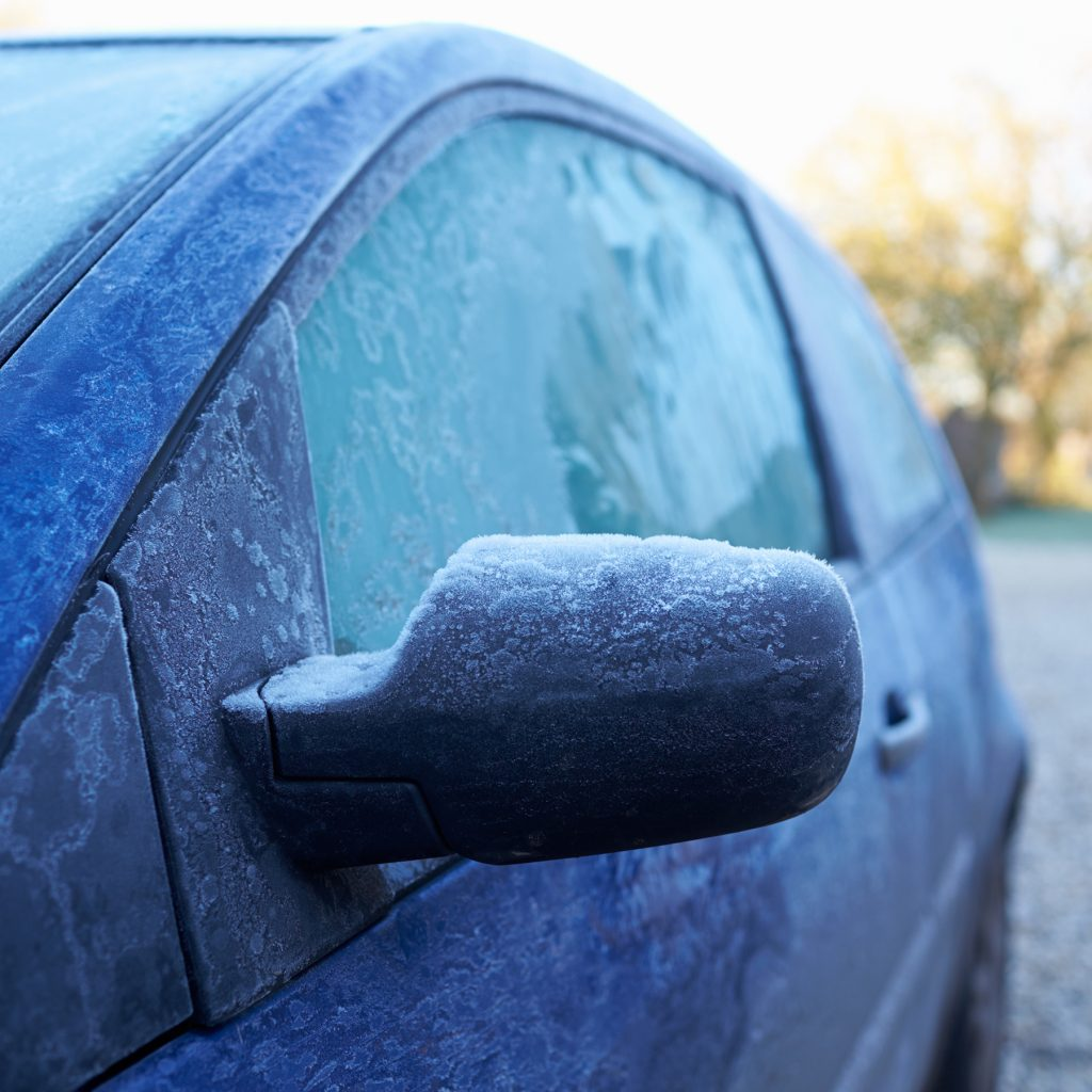 Winter Morning With Ice On Car Exterior