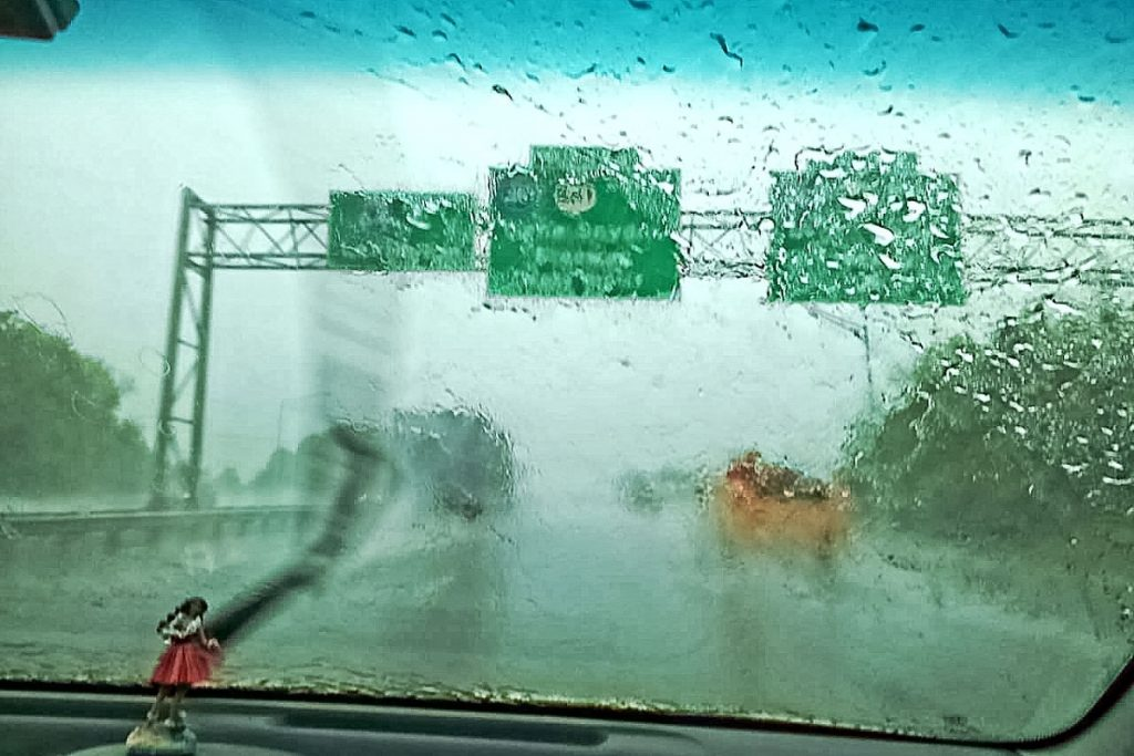 blinded-by-a-downpour-during-a-road-trip-on-the-highway-with-the-windshield-wipers-on-hi_t20_JaGWbP